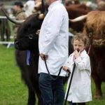 Perth Show…06.08.16 Tara Adams pictured with her dad Ian and Highland cow during the Parade of Champions Picture by Graeme Hart. Copyright Perthshire Picture Agency Tel: 01738 623350  Mobile: 07990 594431