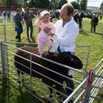Perth Show…06.08.16 Rowan Henderson (11 months) with her dad Duncan and their Zwartbles sheep Picture by Graeme Hart. Copyright Perthshire Picture Agency Tel: 01738 623350  Mobile: 07990 594431